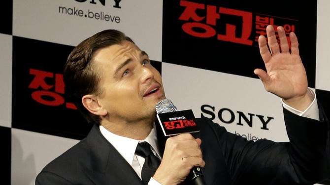 """FILE - In this Thursday, March 7, 2013 file photo, actor Leonardo DiCaprio waves to fans upon arrival for a premiere of his new film """"Django Unchained"""" in Seoul, South Korea. The Hollywood film """"Django Unchained"""" has been pulled from Chinese theaters on its opening day, despite weeks of promotion for director Quentin Tarantino's violent slave-revenge saga. Movie theaters throughout China said Thursday, April 11, 2013 that they were ordered to suspend the film. (AP Photo/Lee Jin-man, File)"""