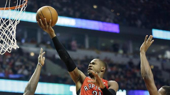 Toronto Raptors guard Terrence Ross (31) drives to the basket as Chicago Bulls forward Luol Deng, left, and guard Jimmy Butler defend during the first half of an NBA basketball game in Chicago on Saturday, Dec. 14, 2013