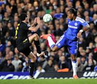 Chelsea's Ivorian striker Didier Drogba (R) vies with Barcelona's Spanish midfielder Sergio Busquets (L) during their UEFA Champions League semi-final first leg football football match at Stamford Bridge in London, England. Chelsea won 1-0
