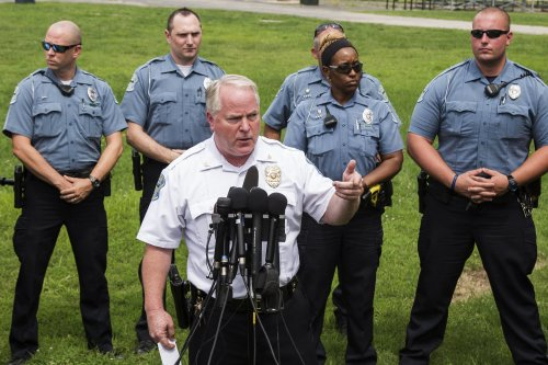 Ferguson Police Chief Thomas Jackson answers questions from the media about his office's handling of the release of information following the shooting of Michael Brown in Ferguson, Missouri in this August 15, 2014 file photo. Missouri authorities are drawing up contingency plans and seeking intelligence from U.S. police departments on out-of-state agitators, fearing that fresh riots could erupt if a grand jury does not indict a white officer for killing a black teen. REUTERS/Lucas Jackson (UNITED STATES - Tags: CIVIL UNREST CRIME LAW POLITICS)