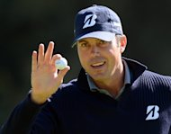 Matt Kuchar putts on the 13th hole to finish seven-under at the first round of the Northern Trust Open, on February 14, 2013. Kuchar's seven birdies on the par-71 Riviera Country Club lay-out included three to open his round