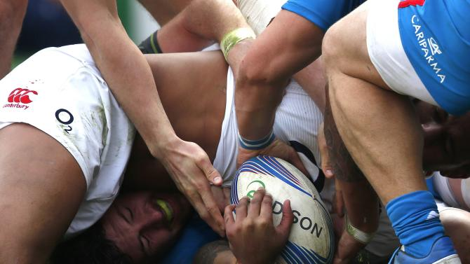 Italy's Leonardo Sarto tries to keep the ball during the Six Nations rugby union match against England at Olympic Stadium in Rome