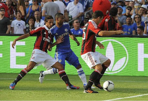 COMMERCIAL IMAGE - In this photograph taken by AP Images for Herbalife, A.C. Milan players Luca Antonini, left, and Daniele Bonera, right, control the ball against Chelsea FC player Ashley Cole at the