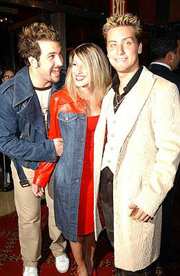 Premiere: Joey Fatone with Lance Bass and his galpal at the New York premiere of On The Line - 10/9/2001