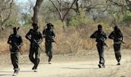 Guards exercise during a parade on April 5, 2013 in Zakouma National Park, 800 kms east of N'Djamena in Chad. In an isolated wilderness in Chad, a war is being fought to save central Africa's decimated elephant herds from gangs of ivory poachers