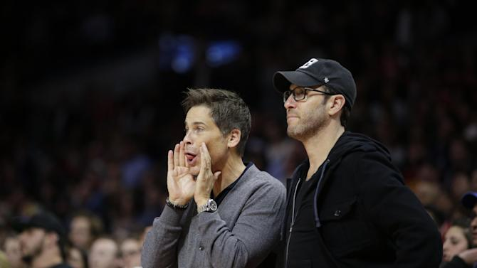 Actor Rob Lowe, left, jokingly distracts a Memphis Grizzlies player at the free throw line during the second half of an NBA basketball game against the Los Angeles Clippers, Monday, Feb. 23, 2015, in Los Angeles. The Grizzlies won 90-87. (AP Photo/Jae C. Hong)