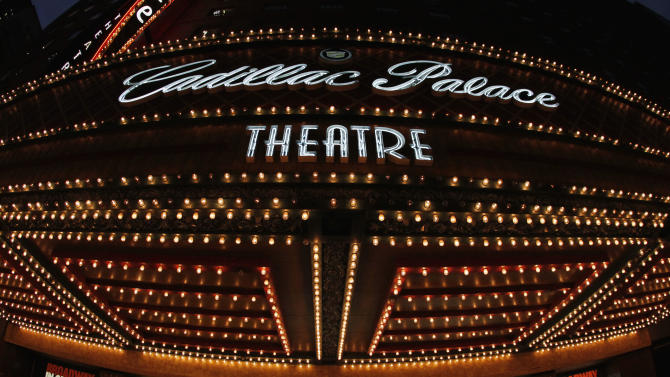 """In this Nov. 19, 2012 photo, the marquee at the Cadillac Palace Theatre promotes the musical """"Les Miserables"""" in the theater district in downtown Chicago. Illinois has been using a recent theater tax credit approved by state lawmakers to attract pre-Broadway and long-run shows to the state. Two musicals recently applied for the tax credit and officials say they're in talks with at least nine other interested productions, and that all together they could bring millions of dollars to the city. (AP Photo/Charles Rex Arbogast)"""