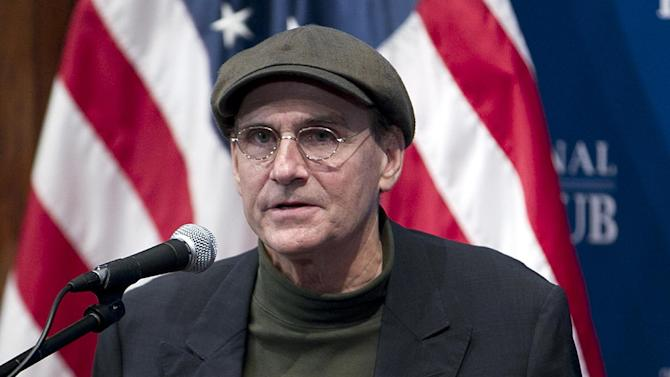 "FILE - This Dec. 7, 2012 file photo shows Grammy Award-winning singer-songwriter James Taylor speaking at National Press Club in Washington. The inaugural committee planning the Jan. 21 event announced Wednesday that Taylor will sing ""America the Beautiful"" at the swearing-in ceremony on the Capitol's west front and  Kelly Clarkson will perform ""My Country `Tis of Thee"" . Beyonce will sing the national anthem at President Barack Obama's inauguration ceremony. (AP Photo/Jose Luis Magana, File)"