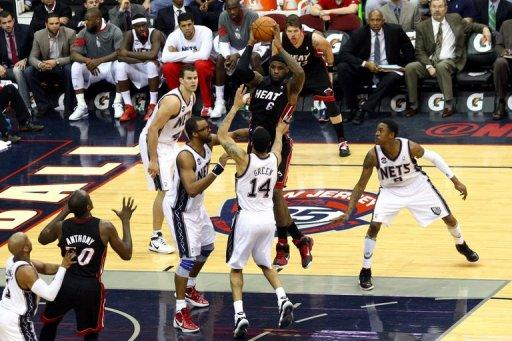LeBron James (with ball) of the Miami Heat during the NBA game against the New Jersey Nets