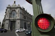 A traffic light near the Banco de Espana (Bank of Spain) in Madrid. European Union finance ministers bought Spain more time to revive its sickly economy on Tuesday, offering 30 billion euros to save the country's banks and protect Europe from more debt contagion
