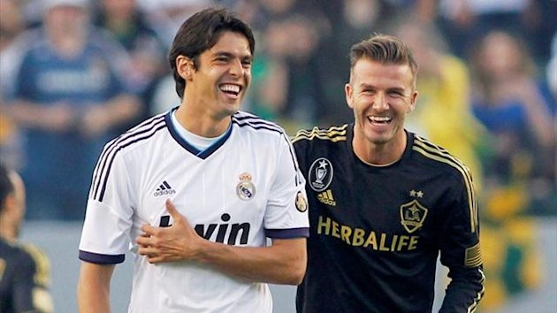 Real Madrid's Kaka shares a laugh with LA Galaxy's David Beckham (Reuters)