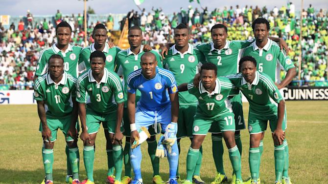 Nigeria's national soccer team top row front left, Mikel John Obi, Omeruo Kenneth, Ideye Brown, Emenike Emmanuel, Godfrey Oboabona, and Ambrose Efe and from bottom left to right, Victor Moses, Echieille Elderson, Enyeama Vincent, Onazi Ogenyi, and Amhed Musa, pose for a group photograph before their 2014 World Cup qualifying match against Ethiopia, at U. J. Esuene Stadium, in Calabar, Nigeria, Saturday, Nov. 16, 2013. Nigeria qualified for the World Cup on Saturday, beating Ethiopia 2-0 in the second leg of their playoff for a comfortable 4-1 aggregate victory