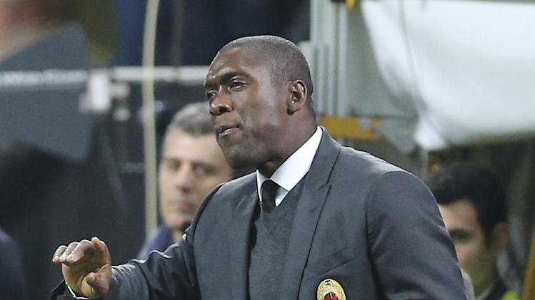 AC Milan coach Clarence Seedorf, of the Netherlands, gestures during the Serie A soccer match between AC Milan and Catania at the San Siro stadium in Milan, Italy, Sunday, April 13, 2014