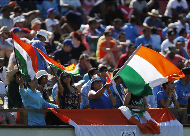 Indian fans cheer on their team during their Cricket World Cup Pool B match against the West Indies in Perth, Australia, Friday, March 6, 2015. (AP Photo / Theron Kirkman)