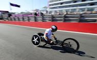Italy's Alessandro Zanardi heads to victory in the men's individual H4 time trial cycling final during the London 2012 Paralympic Games at Brands Hatch circuit, in Kent, southern England
