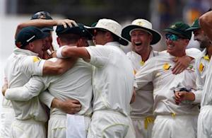 Australia's captain Michael Clarke (2nd R) celebrates with teammates after winning their third Ashes test cricket match against England at the WACA ground in Perth December 17 2013. REUTERS/David Gray