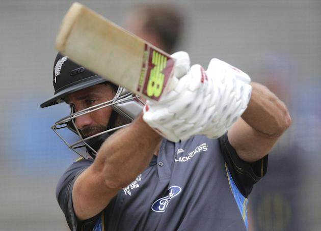 New Zealand's Grant Elliott bats in the nets during a training ahead of the the Cricket World Cup final in Melbourne, Australia, Sunday, March 29, 2015. New Zealand will tackle Australia in the Cricke