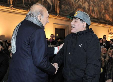 Argentinian soccer legend Maradona shakes hands with former Napoli's soccer team president Ferlaino during the Italian soccer Hall of Fame 2017 event in Florence