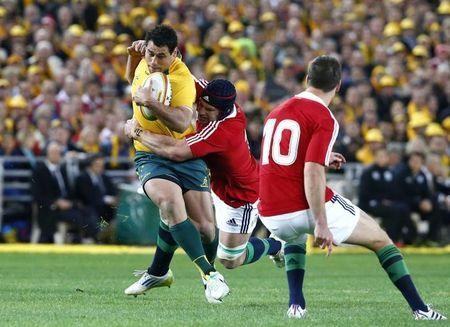 Australia Wallabies' George Smith is tackled by British and Irish Lions' Sean O'Brien during their third and final rugby union test match at ANZ stadium in Sydney