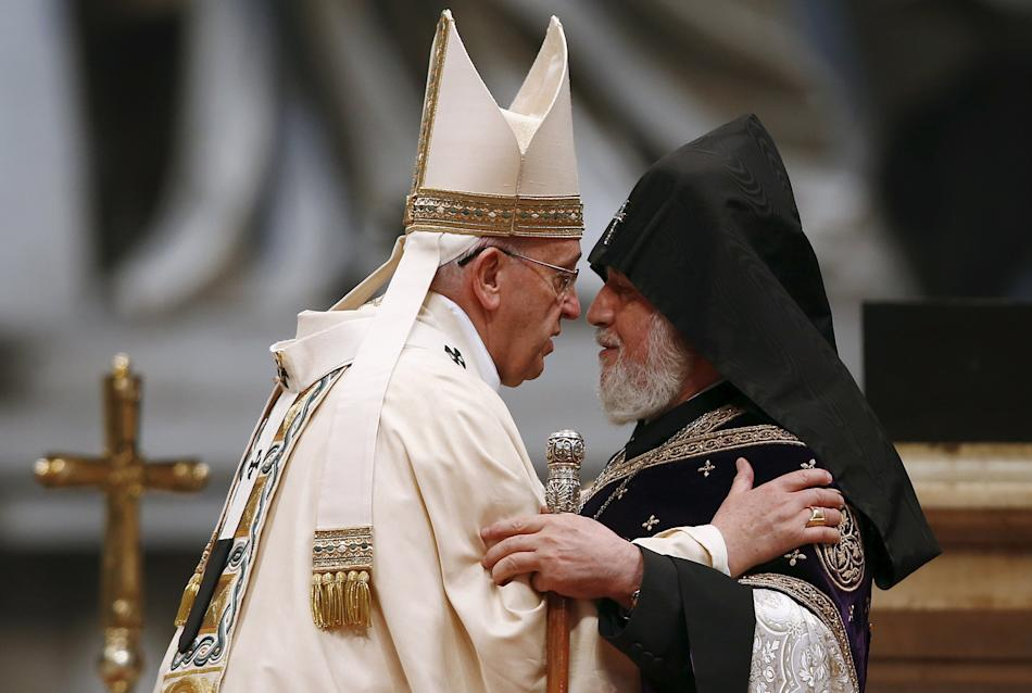 Pope Francis embraces Catholicos of All Armenians Karekin II during a mass on the 100th anniversary of the Armenian mass killings, in St. Peter's Basilica at the Vatican