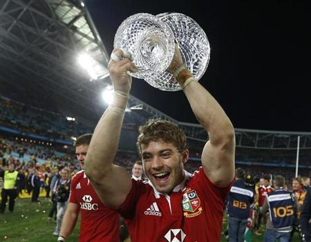 British and Irish Lions' Leigh Halfpenny celebrates with the Tom Richards trophy after winning their series over the Australia Wallabies after their third and final rugby union test match at ANZ stadium in Sydney