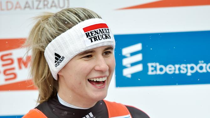 Natalie Geisenberger of Germany celebrates after winning the womens luge World Cup event in the Latvian town of Sigulda on February 19, 2012. AFP PHOTO /ILMARS ZNOTINS (Photo credit should read ILMARS ZNOTINS/AFP/Getty Images)
