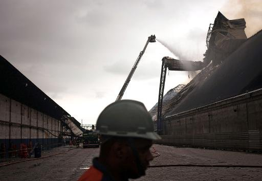 Firefighters attempt to extinguish a fire in a warehouse with sugar at the Brazilian port of Santos, the biggest of Latin America on October 18, 2013