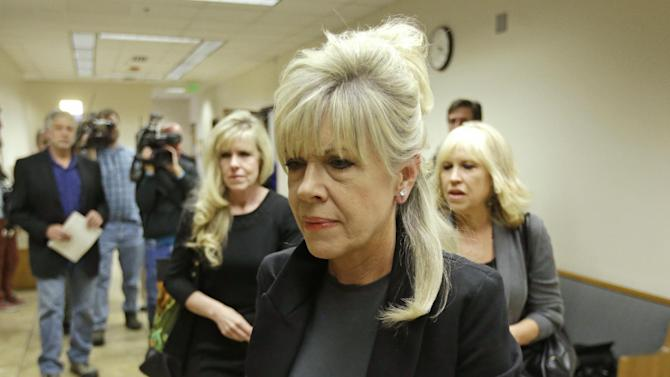 A family member of Michele MacNeill, walks in to the courtroom after a break Thursday, Oct. 17, 2013, in Provo, Utah. Utah. Martin MacNeill, a former doctor, is charged with murder in the 2007 death of his wife. MacNeill, 57, was charged in August 2012, nearly five years after his former beauty queen wife, Michele MacNeill, was found in the bathtub at the couple's Pleasant Grove home, about 35 miles south of Salt Lake City. Prosecutors said they will try to prove that MacNeill got a plastic surgeon to prescribe a powerful set of neurological drugs for her recovery that left her comatose in the bathtub. (AP Photo/Rick Bowmer)
