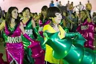 Japanese fashion designer Junko Koshino (right) displays her costumes for the Barroca Zona Sul Samba School in Sao Paulo, on Feburuary 6, 2013. The Japanese avant-garde fashion designer is usually more at ease in the upscale fashion circles of Paris, Beijing or New York but has agreed to help the Barroca Zona Sul samba school for the Sao Paulo Carnival