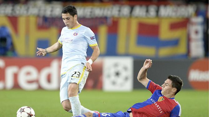 Steaua's Nicolae Stanciu, left, fights for the ball against Basel's Fabian Schaer, during a Champions League group E group stage match between Switzerland's FC Basel 1893 and Romania's FC Steaua Bucharest at the St. Jakob-Park stadium in Basel, Switzerland, Wednesday, Nov. 6, 2013