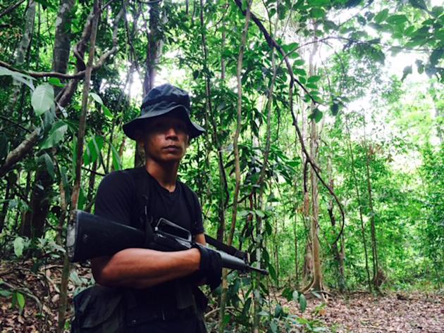 Malaysian Army General Operation Force member leads the way in to the jungle as media visit the Malaysia-Thailand border in Wang Kelian, Malaysia on Tuesday, May 26, 2015. Malaysian authorities said M
