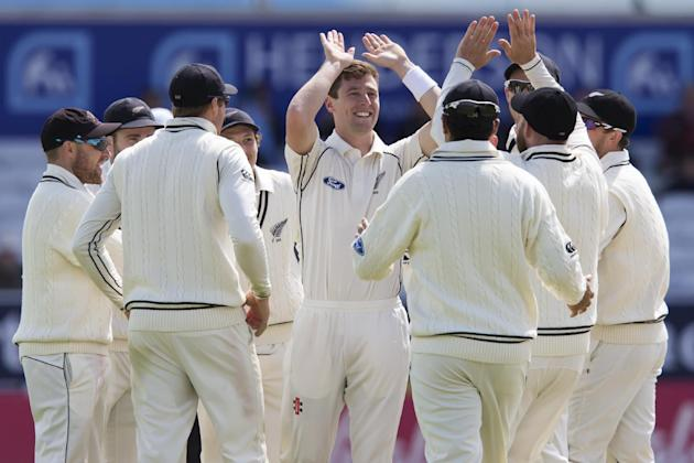 New Zealand's Matt Henry, centre, celebrates with teammates after bowling England's Moeen Ali for 2 on the fifth day of the second Test match between England and New Zealand at Headingley cric