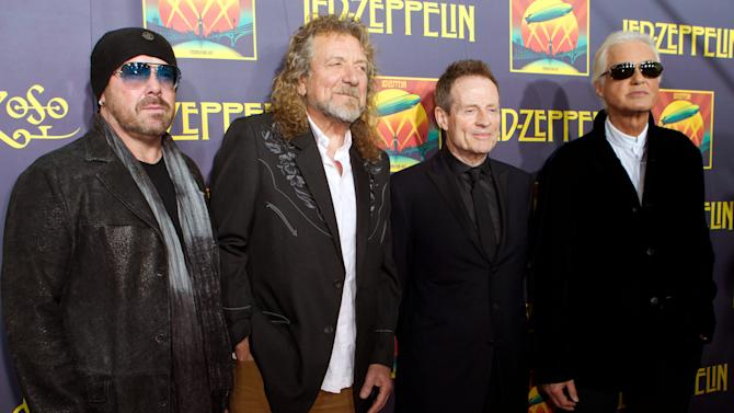 "FILE - This Oct. 9, 2012 file photo shows musicians Jason Bonham, Robert Plant, John Paul Jones and Jimmy Page at the ""Led Zeppelin: Celebration Day"" premiere at the Ziegfeld Theater in New York.  On Monday, Nov. 19, Led Zeppelin's ""Kashmir"" and ""Since I've Been Loving You"" will be featured in next week's episode of ""Revolution"", the same day, Led Zeppelin's ""Celebration Day"" album and a companion documentary on DVD will be released. The series by J.J. Abrams tells of a world 15 years after the world inexplicably suffers a power outage. (Photo by Dario Cantatore/Invision/AP, file)"