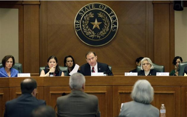 FILE- In this July 29, 2015, photo, Sen. Charles Schwertner, R-Georgetown, center, questions witnesses during a Texas Texas Senate Health and Human Services Committee hearing on Planned Parenthood vid