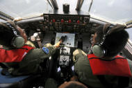 "Indonesian Navy pilots Maj. Bambang Edi Saputro, left, and 2nd Lt. Tri Laksono check their map during a search operation for the missing Malaysian Airlines Boeing 777 over the waters bordering Indonesia, Malaysia and Thailand near the Malacca straits on Monday, March 10, 2014. Dozens of ships and aircraft have failed to find any piece of the missing Boeing 777 jet that vanished more than two days ago above waters south of Vietnam as investigators pursued ""every angle"" to explain its disappearance, including hijacking, Malaysia's civil aviation chief said Monday. (AP Photo/Binsar Bakkara)"