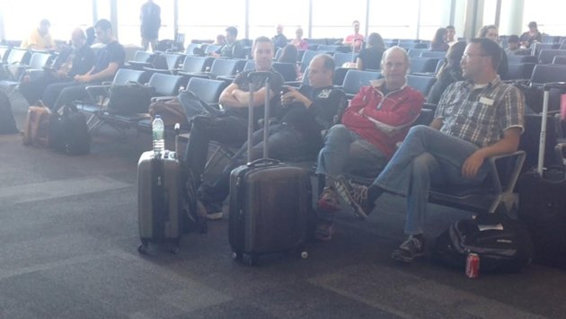Passengers wait after their flight to Brazil was turned back early Thursday. (CBC/supplied photo)