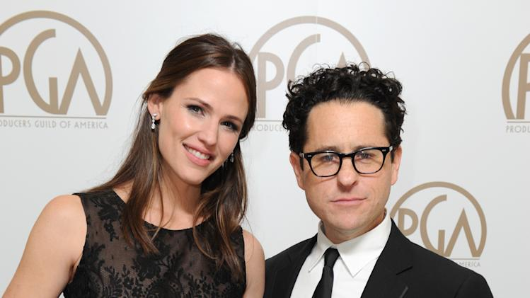 IMAGE DISTRIBUTED FOR THE PRODUCERS GUILD - Jennifer Garner, left, and J.J. Abrams pose backstage at the 24th Annual Producers Guild (PGA) Awards at the Beverly Hilton Hotel on Saturday Jan. 26, 2013, in Beverly Hills, Calif. (Photo by Jordan Strauss/Invision for Producers Guild/AP Images)