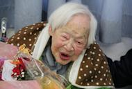 The world's oldest woman Misao Okawa celebrates her 115th birthday at Kurenai nursing home, March 5, 2013 in Osaka, western Japan. Okawa late last month received a certificate from Guinness World Records confirming her status as the oldest living woman