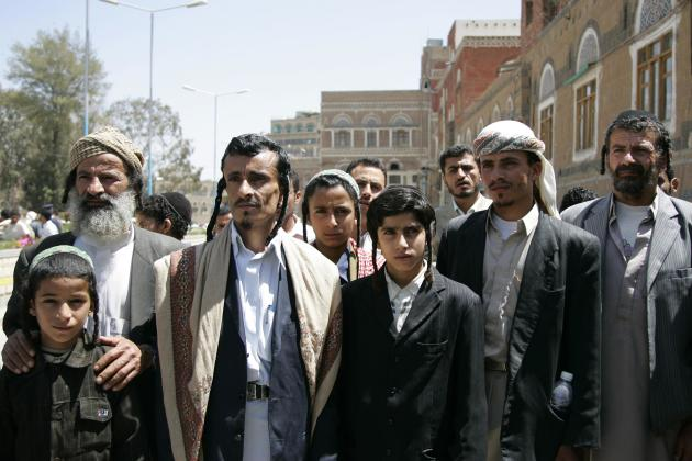 "Yemeni Jews demonstrate demanding the resumption of government financial and food aid to Jewish families living in the capital city outside the Cabinet office in Sanaa in this March 10, 2009 file photo. A few worried families are all that remain of Yemen's ancient Jewish community, and they too may soon flee after a Shi'ite Muslim militia seized power in the strife-torn country this month. Harassment by the Houthi movement - whose motto is ""Death to America, death to Israel, curse the Jews, victory to Islam"" - caused Jews in recent years to largely quit the northern highlands they shared with Yemen's Shi'ites for millennia. But political feuds in which the Jews played no part escalated last September into an armed Houthi plunge into the capital Sanaa, the community's main refuge from which some now contemplate a final exodus. REUTERS/Khaled Abdullah/Files (YEMEN - Tags: CIVIL UNREST POLITICS RELIGION SOCIETY)"