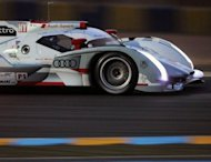 Audi R18 E-Tron Quattro N°1 driven by German Andre Lotterer competes during the third qualifying session of the 80th edition of Le Mans 24 hours endurance race, in Le Mans, western France