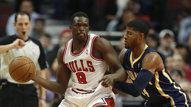 Indiana Pacers forward Paul George guards against Chicago Bulls forward Luol Deng (9) during the first quarter of an NBA basketball game in Chicago, Saturday, Nov. 16, 2013