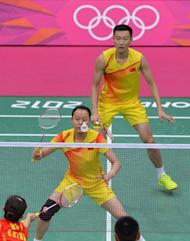 China's Zhang Nan (Top) and Zhao Yunlei play against compatriots Xu Chen and Ma Jin during the badminton mixed doubles gold medal match at the London 2012 Olympic Games