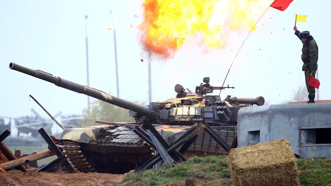 "T-72 tank drives during the Tank Biathlon 2016  competition at the ""Stalin Line"" memorial near the village of Goroshki"