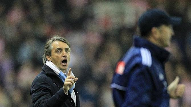 Roberto Mancini (left) and Tony Pulis