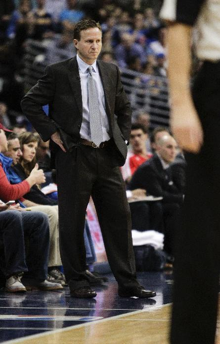Oklahoma City Thunder head coach Scott Brooks stands on the sideline during the first quarter of an NBA basketball game against the Denver Nuggets, Thursday, Jan. 9, 2014, in Denver