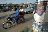 Traffic moves past election campaign posters on a busy road on 19 April 2007 in Warri, Delta State, in Nigeria. Nigerian police have freed international footballer Christian Obodo unhurt during a raid, a day after gunmen kidnapped him in front of a church near Warri and demanded a ransom, a spokesman said Monday