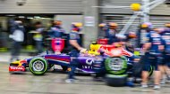 Red Bull Formula One driver Daniel Ricciardo of Australia leaves the pits after a stop during the qualifying session for the the Chinese F1 Grand Prix at the Shanghai International circuit April 19, 2014. REUTERS/Suki Srdjan/Pool (CHINA - Tags: SPORT MOTORSPORT F1)