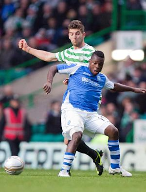 Nigel Hasselbaink, blue shirt, rescued a point for St Johnstone