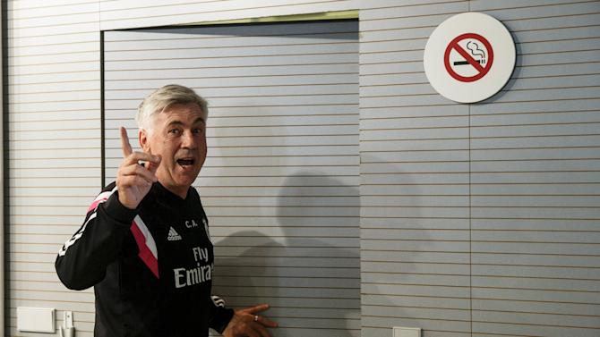 Real Madrid coach Carlo Ancelotti leaves after a news conference at Valdebebas, outside Madrid, Spain