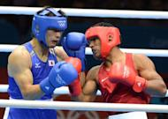 Ryota Murata of Japan (in blue) fights Esquiva Falcao of Brazil during the middleweight (75kg) boxing final of the 2012 London Olympic Games. Murata won Japan's first Olympic boxing gold for 48 years when he claimed the middleweight (75kg) title with a 14-13 win over Falcao